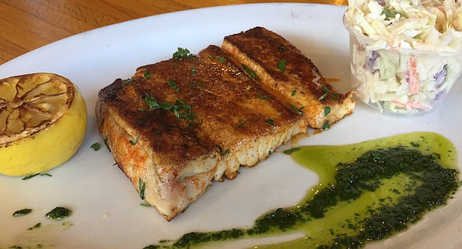 Grilled yellowtail served with an herb salsa verde