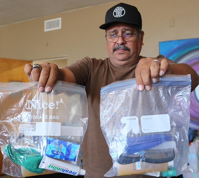Ricardo and his wife were prepping dozens of one-gallon ziplock baggies.