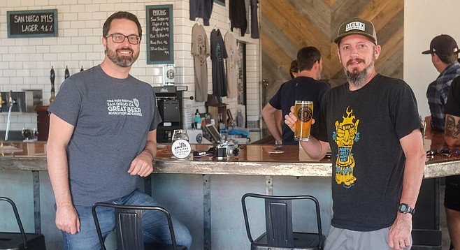 Bill Vanderburgh and Rob Strobel drink beer at Latchkey Brewing Company.