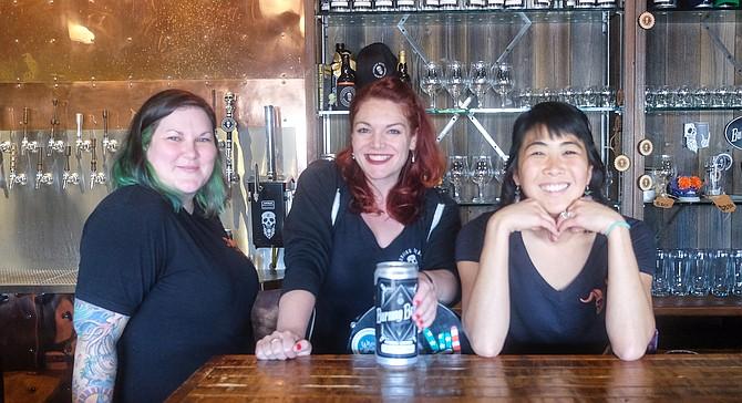 Stina O'Grady, Shannon Lynette, and Nikki Kojima contribute to the customer experience at Burning Beard.