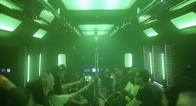 Passengers chat amid cannabis smoke during a Bud & Brews tour.