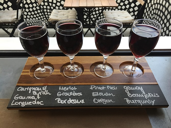 Red wine flight, with generous pours