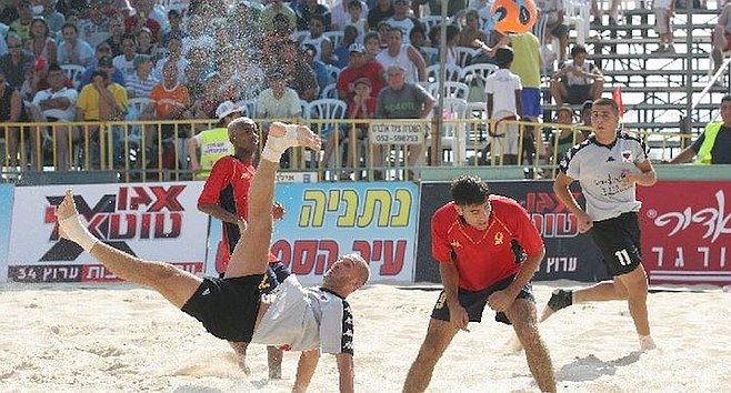 Players in Netanya, Israel compete in the sand.