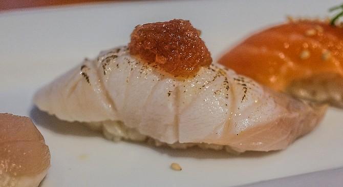 Gindara: seared black cod nigiri, topped by a blend of daikon radish and ponzu.