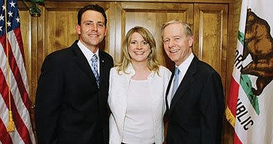 "Nathan, Mindy, and ex-governor Pete Wilson. Nathan: ""If elected, the income I would earn from that position would be $172,451."""