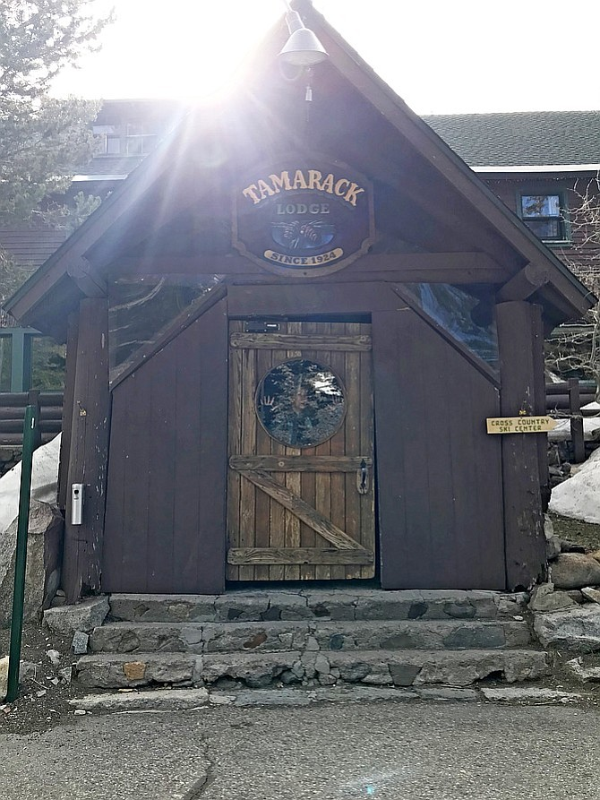 Rustic cabin-looking entrance to Tamarack Lodge.