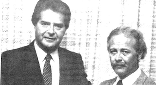 Hannibal (right) gets commendation from police chief Kolender, 1983.
