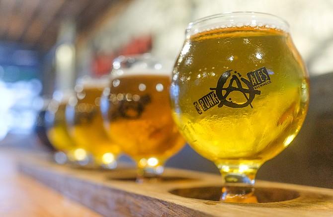 A flight of 3 Punk Ales beers, beginning with La Flama Blanca.