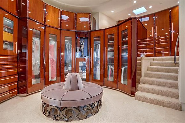 Just one of the many walk-in closets