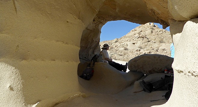 The wind-carved caves make a shady resting place