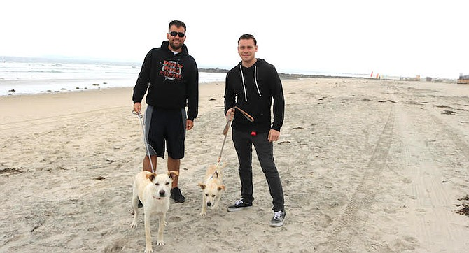 """Brandon and Raul. """"The dogs need more room to run."""""""