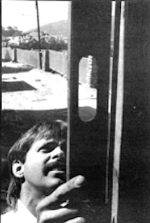 Tony Bochene checks vertical square of corner support.