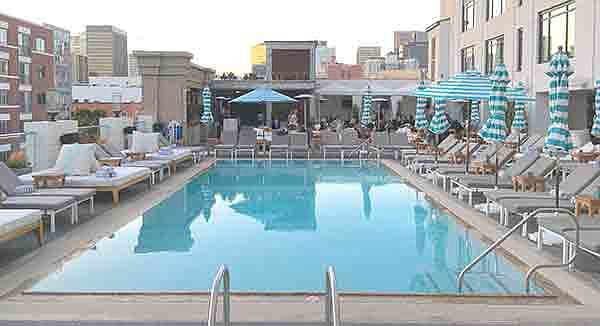 The pool at the Pendry, with happy hour revelers in background
