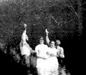 Ramey Creek. Seconds after this photo was taken, the preachers plunged the two young women under the slow-moving water.