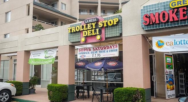 A small sandwich shop near a trolley stop