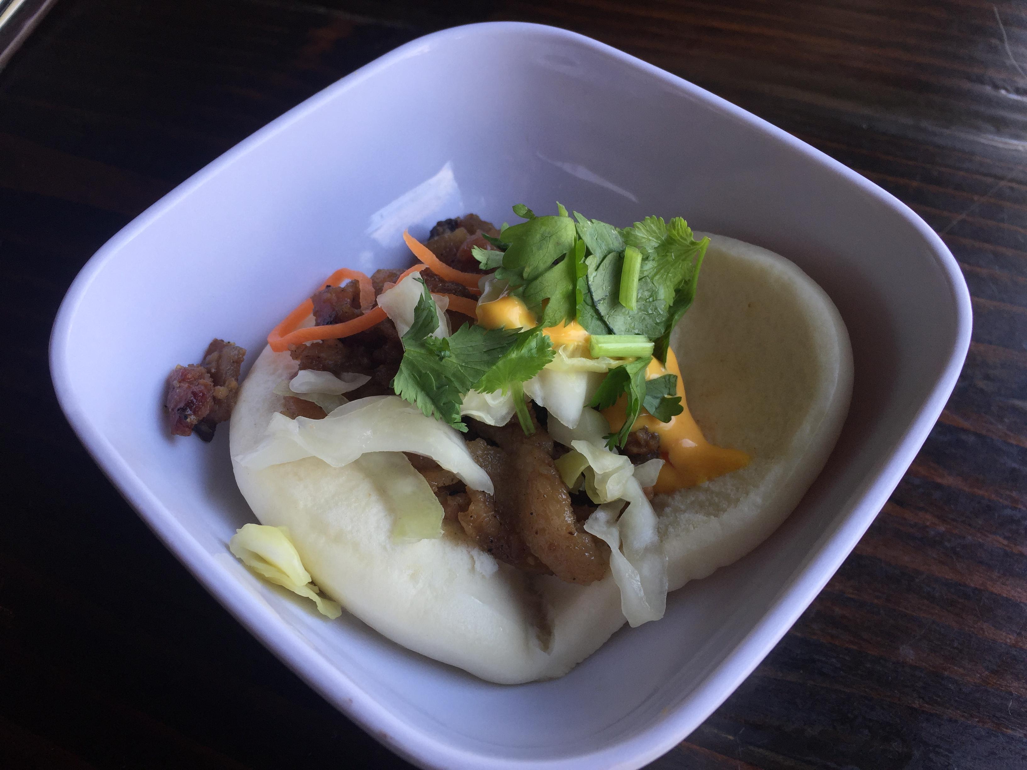 Korean style pork belly taco on a bao bun