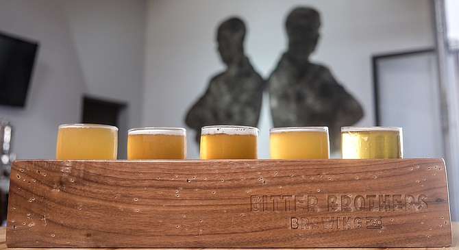 A flight at Bitter Brothers, starting with a pilsner, ending with a sour.
