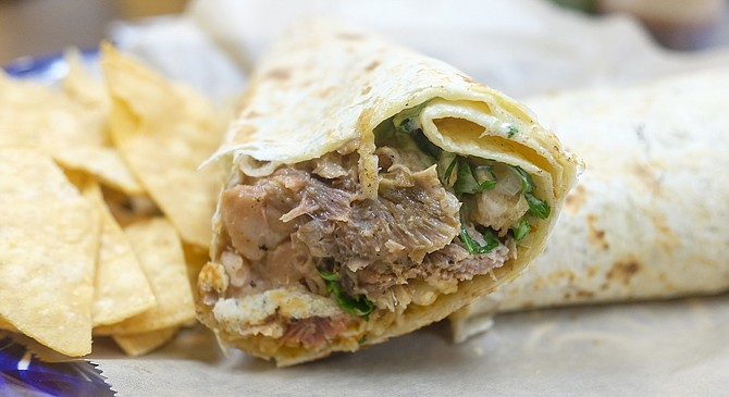 A 24-hour marinated lamb wrapped in a flour tortilla with pinto beans and rice.