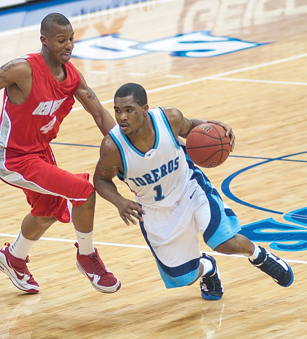 Brandon Johnson playing for USD. The FBI tapped revealing phone calls between Johnson and T.J. Brown, a former USD assistant coach.
