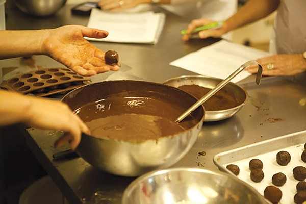 Dallmann Chocolates. Learn how to tell good chocolate from bad, how to infuse chocolate, and rolling and piping truffles.