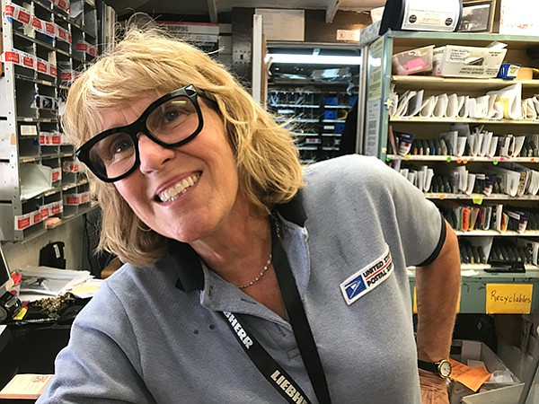 Postmistress Karen: big smiles in a tiny post office