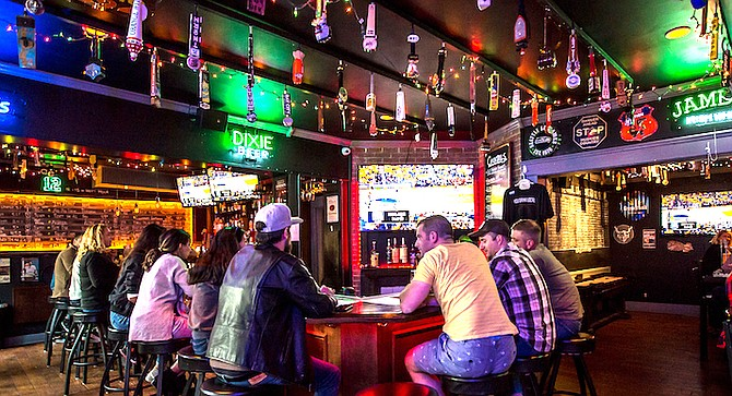 An expanded bar reflects that beer taps are no longer front and center at Project Bar & Grill.