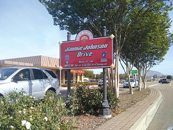 Champion NASCAR driver and El Cajon native Jimmy Johnson is honored by a sign on Second Street.