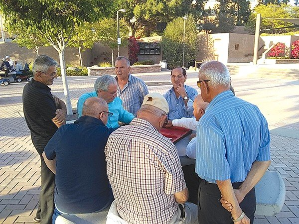 Chaldean men at backgammon game outside the courthouse off Main Street