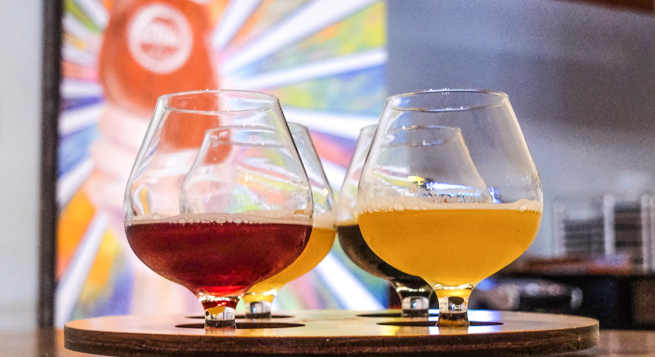 A beer flight: hoppy, fruity, tart, and stout.