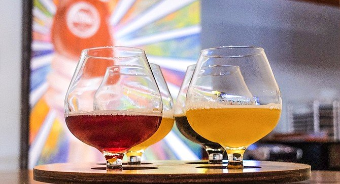 A beer flight: hoppy, fruity, tart, and stout.