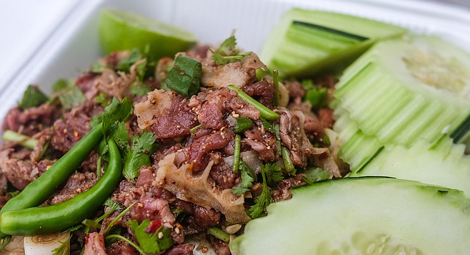 The more authentic Laotian laab, with raw beef, beef bile, and honeycomb tripe.