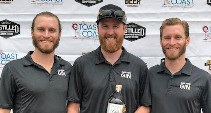Jordan Kohn, Justin Wilkinson, and Ryan Kohn celebrate their gold medal gin. Photo courtesy Pier View Gin.