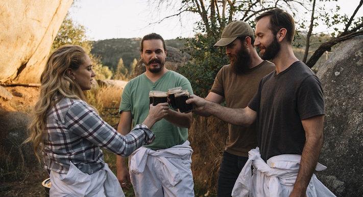 Meg Gill drinks braggot with John Botica, Andrew Segina, and Mark Oberle.