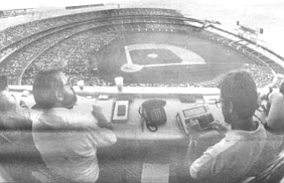 Press box. The Padres have just lost to the Houston Astros, 5-3. Up in the press box, the local sports writers pack up their notes and score books and scramble for the elevator, which will take them to the clubhouse.