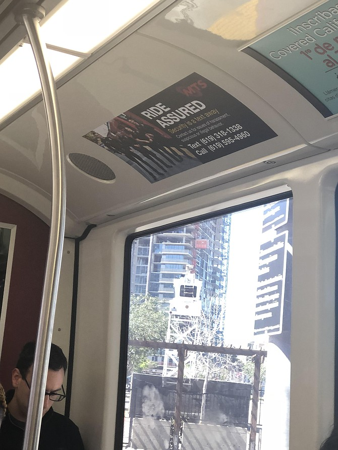 Trolley signage may not specifically mention graffiti, as all incidents are reported through the same portals.