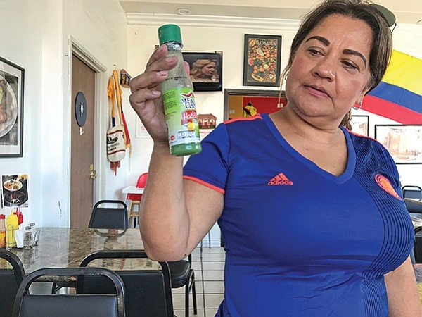Patricia holds token salsa for Mexican customers - not a Colombian thing.