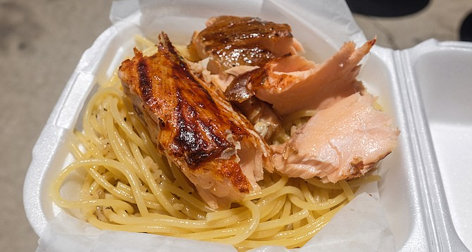 A flaky, flame-frilled cedar plank salmon over noodles