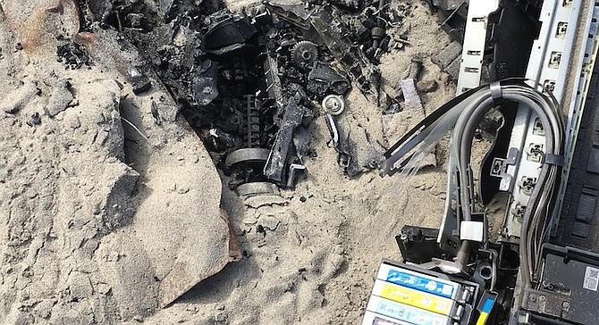 Burnt printer in Mission Beach firepit
