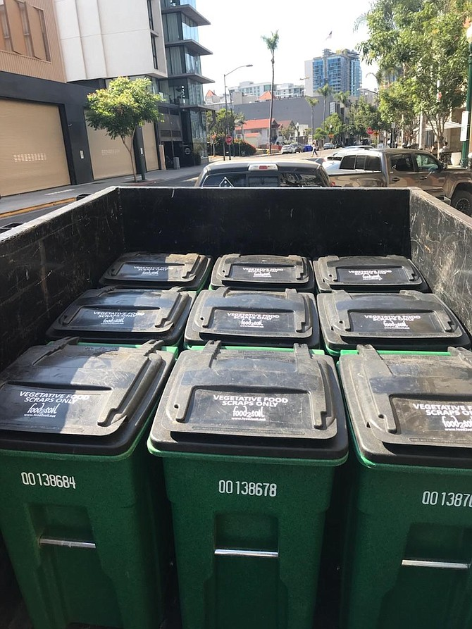 Weekly pickup of carts from various points in the City for composting at community gardens