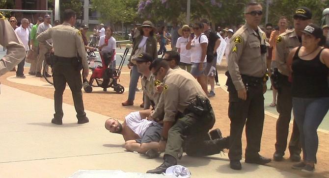 San Diego deputy sheriffs apprehended Siminou.