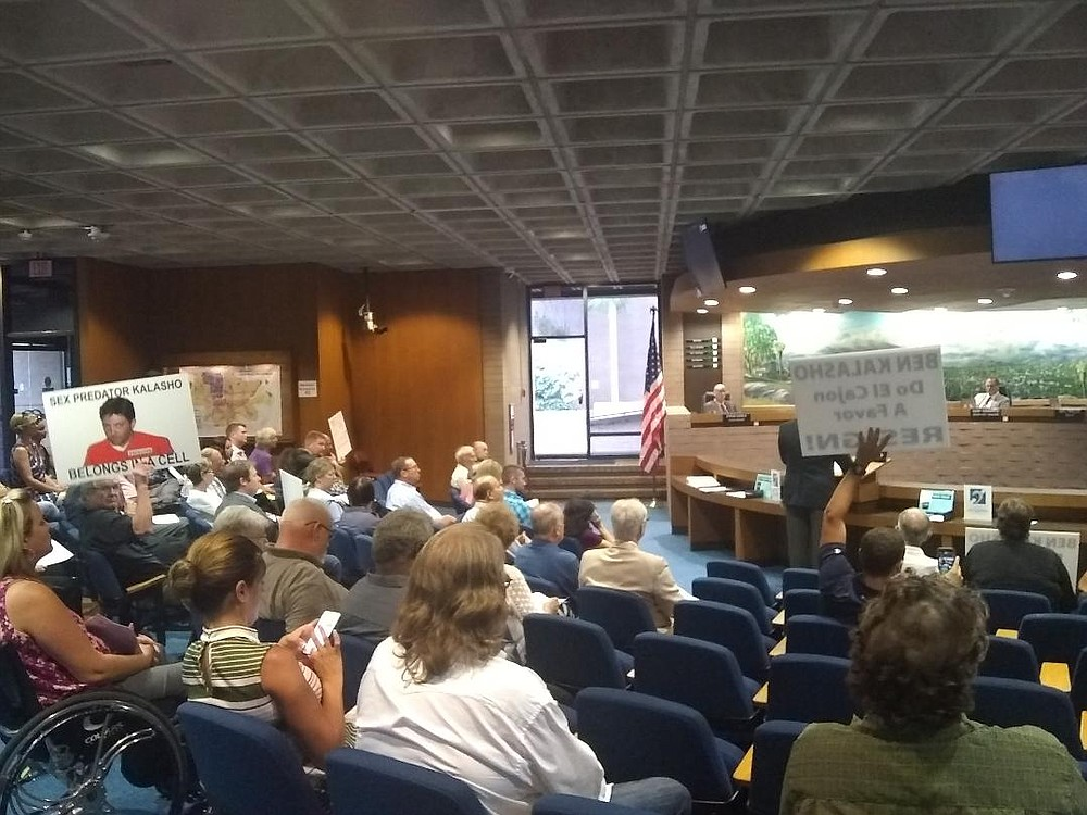 July 10 El Cajon City Council meeting. Kalasho laughed at some, cringed before others and seemed to pay attention to a few.