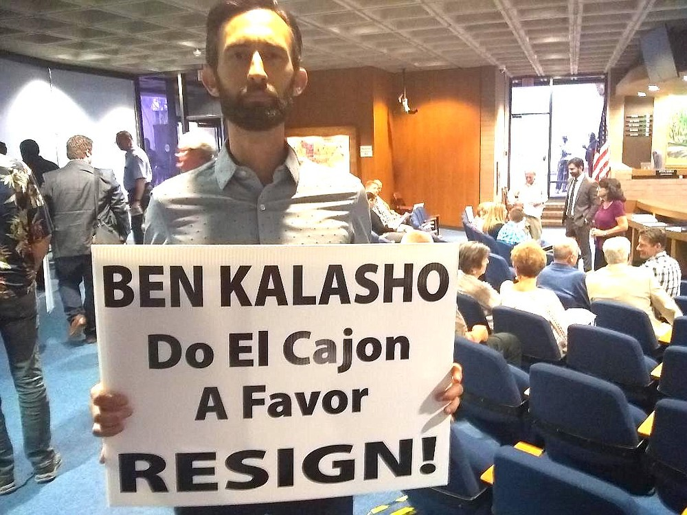 """Taylor Abeel with sign. """"I do not believe you are fit to make ethical decisions on our behalf."""""""