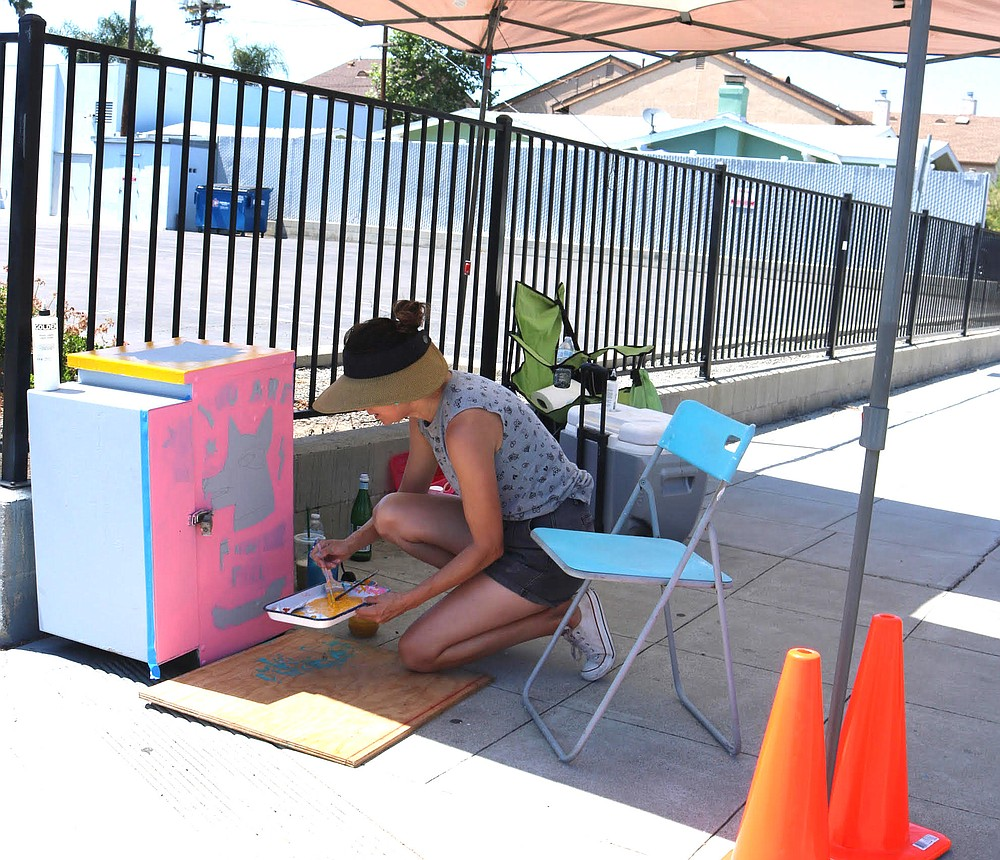 """Janine Wareham at 34th and Adams: """"I'm trying to paint a bunch of positive messages for the community,"""""""
