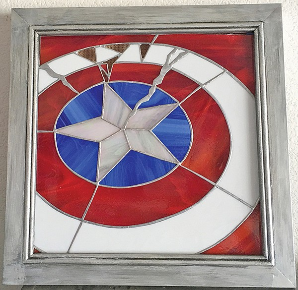Battle-damaged stained-glass shield