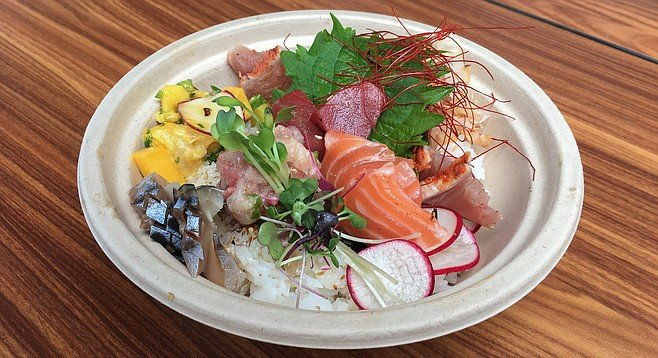 The Single Fin rice bowl eats like omakase sashimi and vegetables served on a bed of rice.