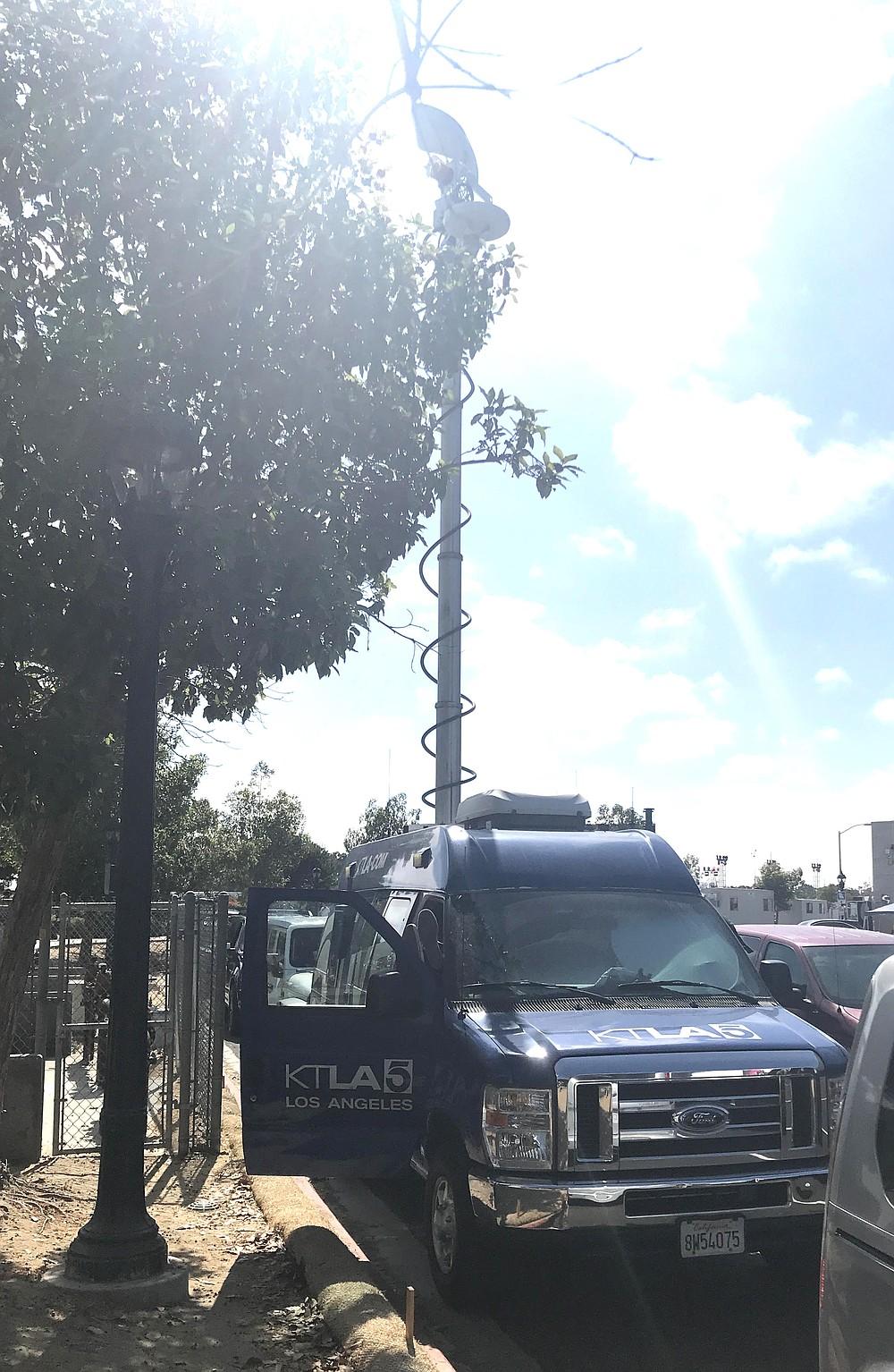 KTLA 5 news van parked on Park Boulevard by a red curb