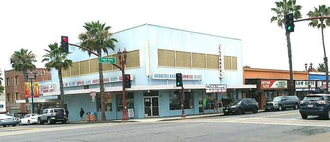 North Coast Hwy. and Pier View Way. Mary Cathay bought the building in 1948 to house military uniform and embroidery businesses.