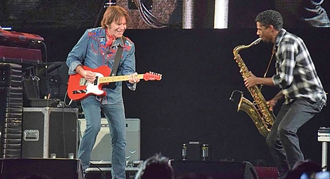 John Fogerty told Nathan Collins his sax solos are better than Forgerty's originals.