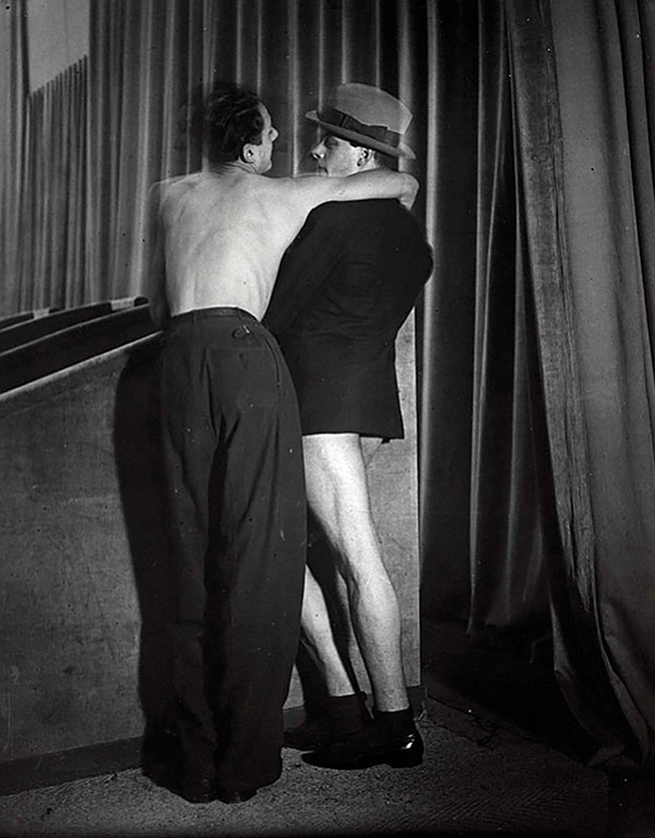 Brassaï, Young couple wearing a two-in-one suit at the Bal de la Montagne Sainte-Genevieve, c. 1931.