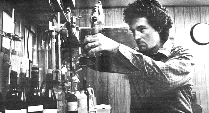 """Kerry Damskey in the lab. """"Nobody puts gamay on the table at a fancy dinner party."""" - Image by Jim Coit"""